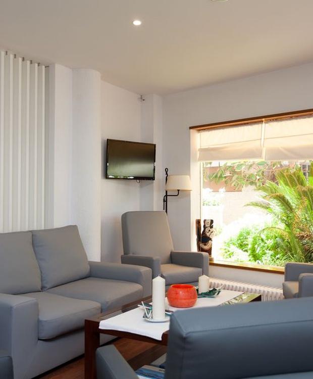 Sala de estar Hotel Los Geranios